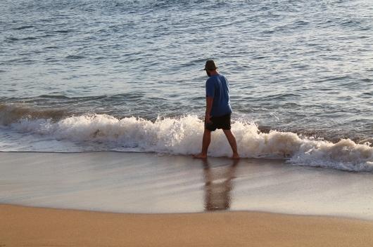 IMG_5558 man walking on beach